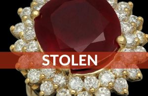 Stolen – Ruby Ring Oval Cut with Large White Diamonds Ringing Around It, Yellow Gold